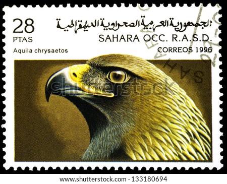 "SAHARA - CIRCA 1996: A stamp printed in Sahrawi Arab Democratic Republic, shows a Aquila chrysaetos bird, with the same inscription, from the series ""Birds of prey"", circa 1996 - stock photo"