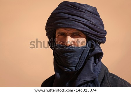 SAHARA DESERT, DJANET, ALGERIA, FEB 25: Tuareg in the Sahara desert, Djanet, Algeria, February 25, 2011. Nomadic tribes living in the desert, and a traditional lifestyle as a hundred years ago.  - stock photo