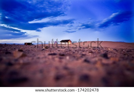 Sahara desert doors area scene. Sunset with tents, Zagora, Morocco - stock photo