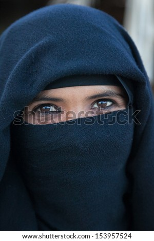 SAHARA DESERT, EGYPT - YAN 26: Portrait of the unknown young berber woman in the Sahara Desert, Egupt, Yanuary 26, 2010. Tribes of bereber wander across all North Africa from Morocco to Egypt. - stock photo
