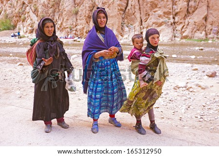SAHARA DESERT, MOROCCO 20 OCTOBER 2013: Nomad women in the Sahara desert, Morocco. Nomadic tribes living in the desert, and a traditional lifestyle as a hundred years ago. - stock photo