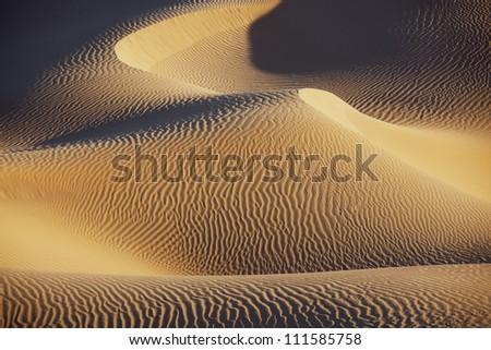 Sahara desert sand dunes at Erg Lihoudi, M'hamid, Morocco. - stock photo