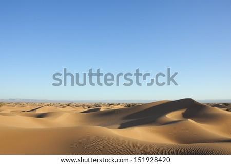 Sahara desert sand dunes with clear blue sky, Morocco. - stock photo