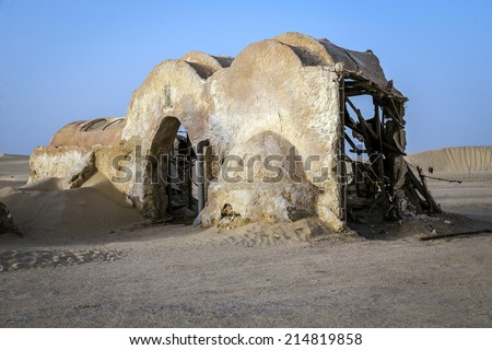 SAHARA, TUNISIA - AUGUST 18, 2014: Abandoned sets for the shooting of the movie Star Wars in the Sahara desert on a background of sand dunes in Sahara, Tunisia - stock photo