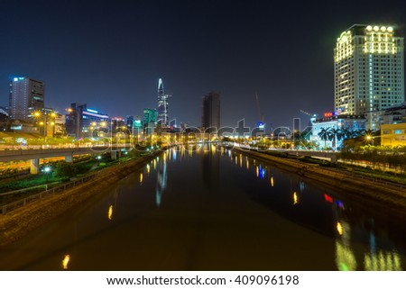 SAI GON, VIET NAM - 15 APR 2016: Cityscape of Ho Chi Minh at night with bright illumination of modern architecture, viewed over Saigon river in Southern Vietnam.