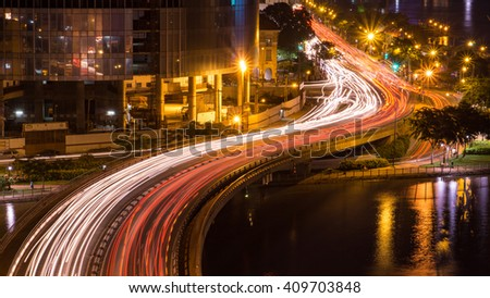 SAI GON, VIET NAM - 15 APR 2016: Cityscape of Ho Chi Minh at night with bright illumination of modern architecture, viewed over Saigon river in Southern Vietnam