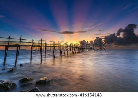 SAI GON, VIET NAM - JAN 10, 2016: sunrise on the sea with shadow rudimentary leaves home on the Can Gio sea.