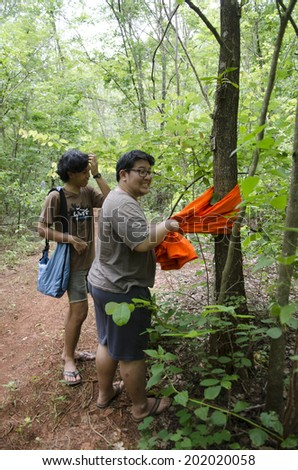 SAI YOK, KANCHANABURI, THAILAND - JULY 1: UnidentifiedCommunity residents are religious rituals on forest conservation at Ban Chong Kab Sacred Grove Forest on July 1, 2014 in Sai Yok, Thailand