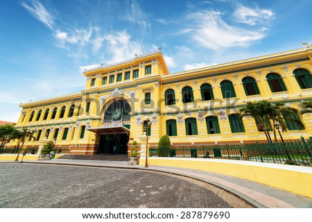Saigon Central Post Office on blue sky background in Ho Chi Minh, Vietnam. Steel structure of the gothic building was designed by Gustave Eiffel. Ho Chi Minh is a popular tourist destination of Asia. - stock photo