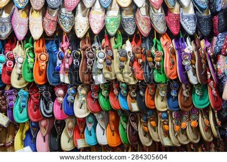 SAIGON - FEB 5, 2015 -  Shoes and sandals on display, Ben Thanh market, Saigon (Ho Chi Minh City),  Vietnam - stock photo