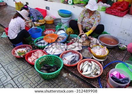 SAIGON - FEB 5, 2015 - Woman preparing fish for sale at the Ben Thanh Market in Saigon (Ho Chi Minh City),  Vietnam