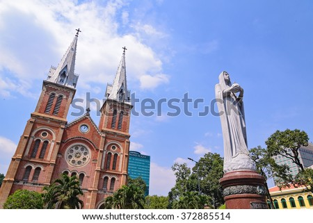 Saigon Notre-Dame Cathedral Basilica (Basilica of Our Lady of The Immaculate Conception) on blue sky background in Ho Chi Minh city, Vietnam. Ho Chi Minh is a popular tourist destination of Asia. - stock photo