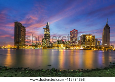SAIGON, VIETNAM - APR 04, 2015 : Enjoy the sunset from the other side Saigon Ben Nghe canal in Ho Chi Minh City (Saigon). - stock photo