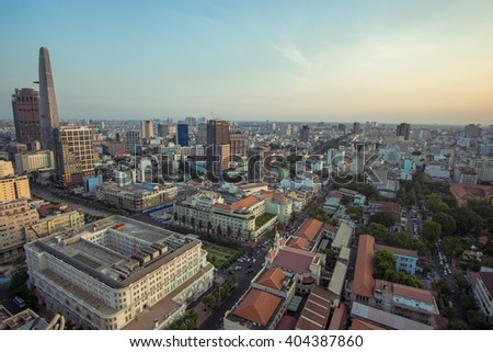 SAIGON, VIETNAM - APRIL 09, 2016: Development of district 1, Ho Chi Minh City with many modern buildings and offices at sunset.