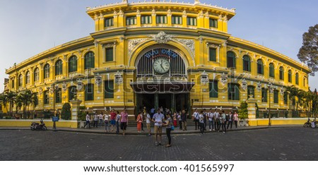 SAIGON, VIETNAM - April 05, 2016 -  View of tourists and pedestrians pass by the post office on April 05, 2016 in Ho Chi Minh City, Vietnam.