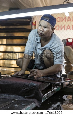 SAIGON, VIETNAM - DEC 29: An unidentified worker finishing a handicraft at the factory in Ho Chi Minh city. The Vietnamese government has recognised about 1500 handicraft villages. On Dec 29, 2013.