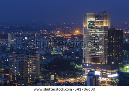SAIGON, VIETNAM - DEC 23, 2016 : Impression landscape of Ho Chi Minh city at night , Saigon river flows through the city, this photo was taken at Sai Gon pearl building.
