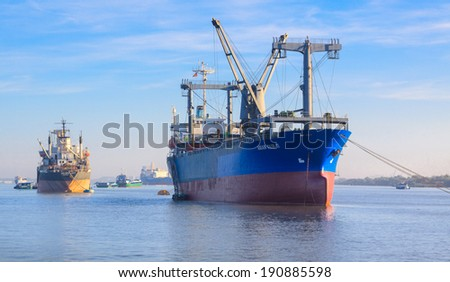 SAIGON, VIETNAM - DEC 16: The Asian Fair II and others cargo ships in Saigon river, Vietnam.  On Dec 16, 2012.  - stock photo