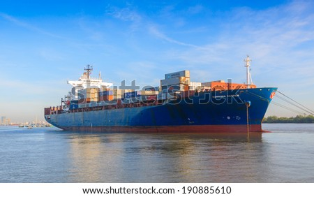 SAIGON, VIETNAM - DEC 16: The Hammonia Caspium cargo ships in Saigon river, Vietnam.  On Dec 16, 2012.  - stock photo