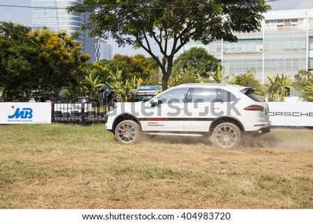 saigon vietnam marc 21 2016 white porsche cayenne turbo running on the