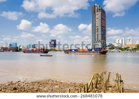 SAIGON, VIETNAM - MARCH, 17, 2015. Business and Administrative Center of Ho Chi Minh city on Saigon riverbank (view from Thu Thiem) in the morning. Ho Chi Minh city is the biggest city in Vietnam. - stock photo