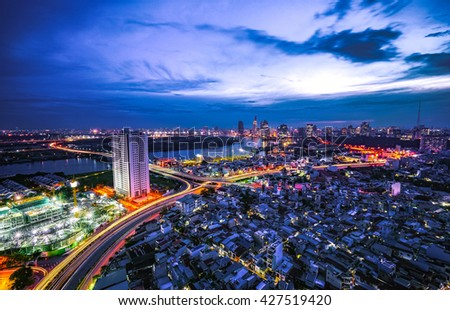 SAIGON, VIETNAM - NOV 18, 2015. Cityscape of Saigon downtown, viewed from top of building. Saigon (Ho Chi Minh city) is the largest city in Vietnam with population around 10 million people. - stock photo