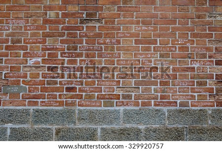 Saigon, Vietnam - Oct 21, 2015: Many uneducated people write their names on the wall of Saigon Notre-Dame Basilica. The wall of cathedral built with bricks from France, have been defaced by graffiti.