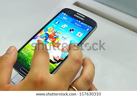 SAIGON, VIETNAM - OCTOBER 8 : Samsung S4 applications including Google+, Messenger, Talk, Group Play, Story Album, Play Store, Youtube, Play Music, Chrome, Gmail, runs Android 4.2 in October 8, 2013 - stock photo