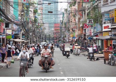 Saigon, Vietnam-October 25. The streets of Saigon(Ho Chi Min City) are crowded with scooters, motorbikes and bicycles, October 25, 2009. Over 9 million people, it is the most populous city in Vietnam - stock photo