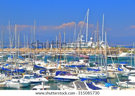 Sail and motor boats inside the harbor of Antibes, French Riviera, France - stock photo