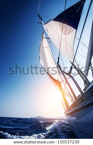 Sail boat in action, summer adventure, luxury water transport, sunset light, active lifestyle, recreation in the sea, travel and tourism concept  - stock photo