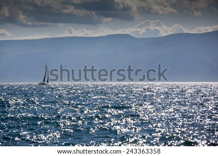 sail boat on open sea - stock photo