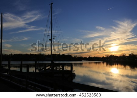 sail boat sunset - stock photo