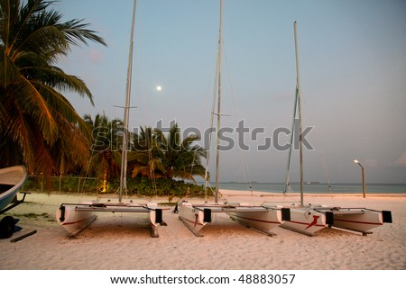 Sail boats parked on the beach
