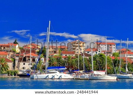Sail boats tied to the pier in Trogir, Croatia - stock photo