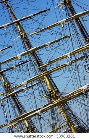 Sail ship masts with blue sky background