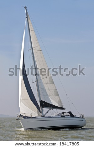 Sail yacht sailing on the IJsselmeer in the Netherlands