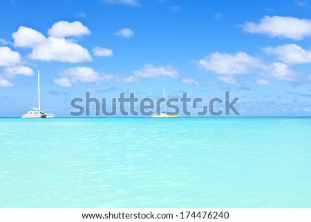 Sail yachts in a blue caribean sea - stock photo