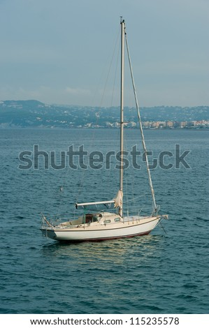 sailboat anchored in the Mediterranean Sea