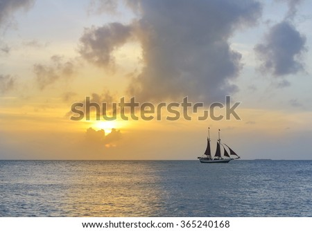 sailboat and a marvellous sunset - stock photo