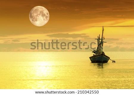 Sailboat and full moon - stock photo
