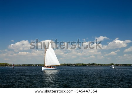Sailboat as viewed from the Chesapeake Bay Maritime Museum in St. Michael's, Maryland on a beautiful Spring day. - stock photo