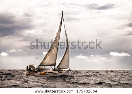 Sailboat at slightly rough sea