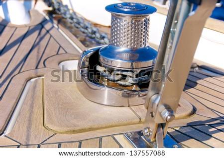 Sailboat bow, winch detail, Italy - stock photo