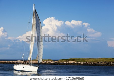 Sailboat coming in the inlet Montauk Point, Long Island , New York. - stock photo