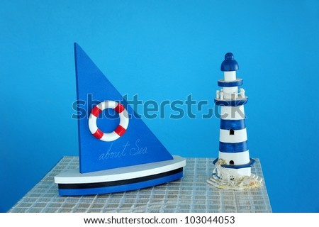 Sailboat decoration with blue wall