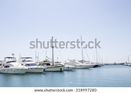 Sailboat harbor, many beautiful moored sail yachts in the sea port, modern water transport, summertime vacation, luxury lifestyle and wealth concept - stock photo