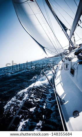 Sailboat in action, extreme sport, luxury water transport, summer vacation, cruise in the sea, active lifestyle, travel and tourism concept - stock photo