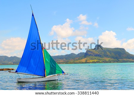 Sailboat in Mahebourg bay with Morne Brabant on background. Mauritius island. - stock photo