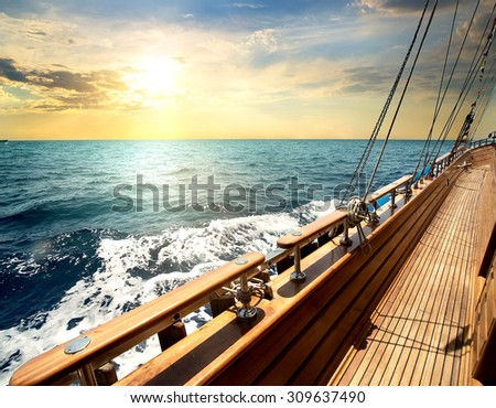 Sailboat in red sea at the sunset - stock photo